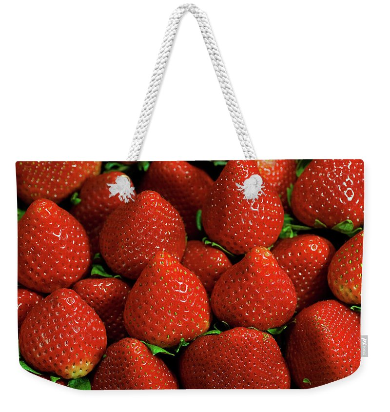 Large Group Of Objects Weekender Tote Bag featuring the photograph Strawberry Cliche by By Ken Ilio