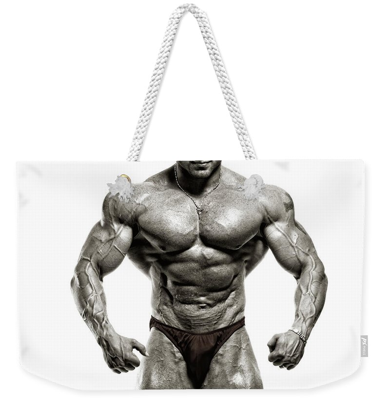 Abdominal Muscle Weekender Tote Bag featuring the photograph Strong Male Model by Spanic