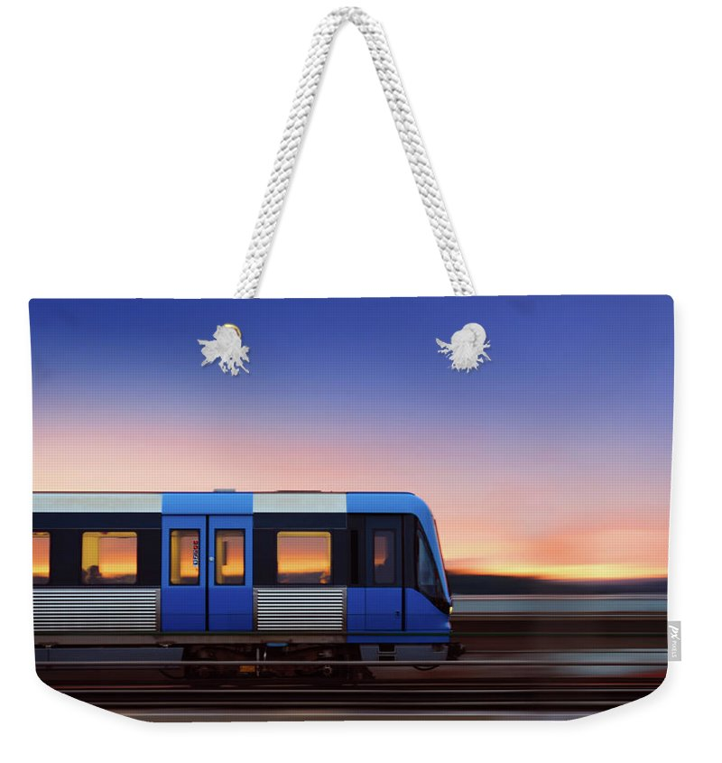 Train Weekender Tote Bag featuring the photograph Subway Train In Profile Crossing Bridge by Olaser