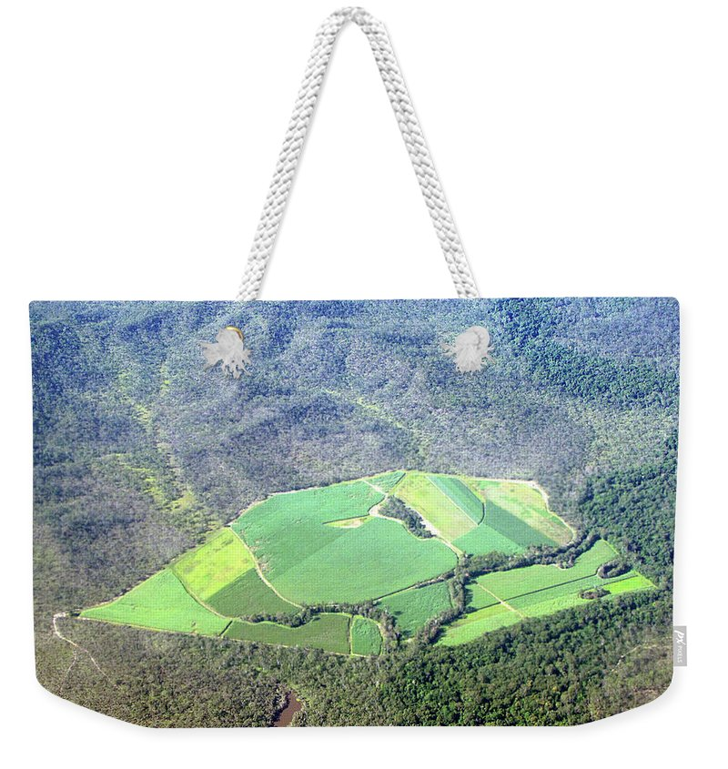 Cairns Weekender Tote Bag featuring the photograph Sugar Canefields Carved Out Of Forest by Photography By Mangiwau