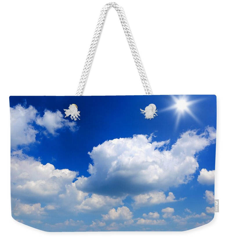Scenics Weekender Tote Bag featuring the photograph Sun And Clouds by Macroworld