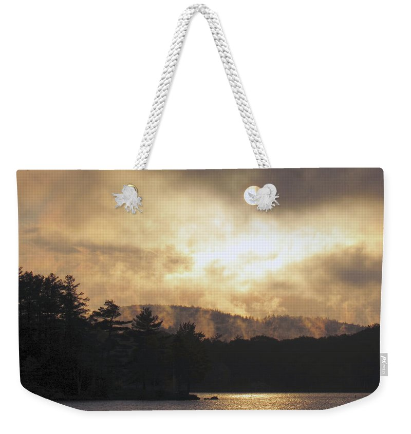 Sun Weekender Tote Bag featuring the photograph Sun Behind The Clouds by Inge Van Balkom