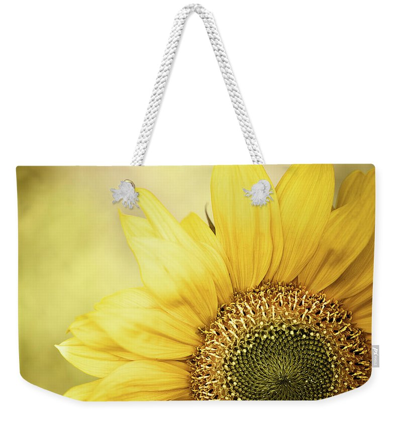 Outdoors Weekender Tote Bag featuring the photograph Sunflower Blossom With Bokeh Background by Elisabeth Schmitt