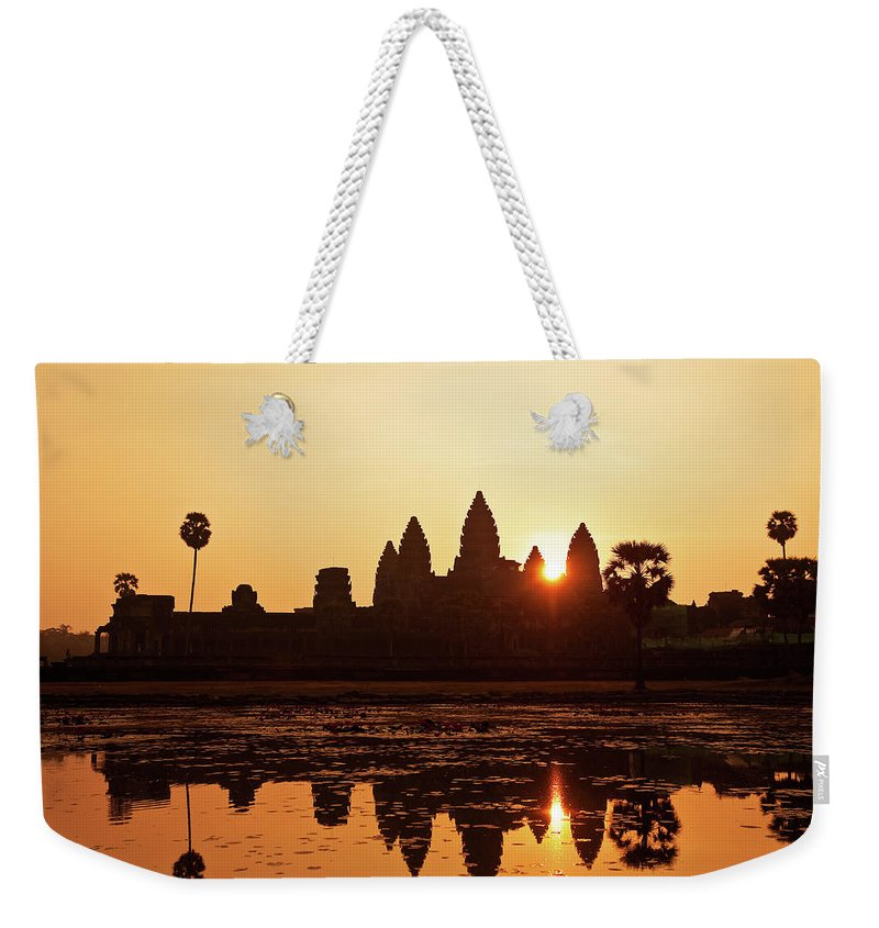 Southeast Asia Weekender Tote Bag featuring the photograph Sunrise At Angkor Wat, Cambodia by Raisbeckfoto