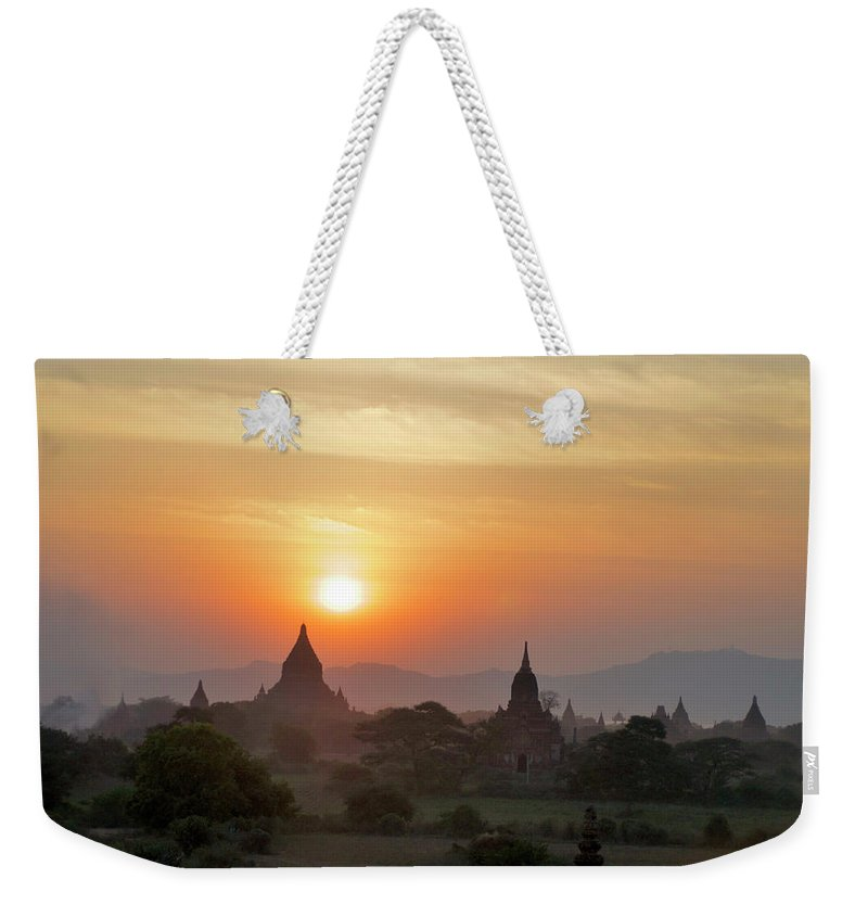 Tranquility Weekender Tote Bag featuring the photograph Sunset From Atop The Shwesandaw Paya by Jim Simmen