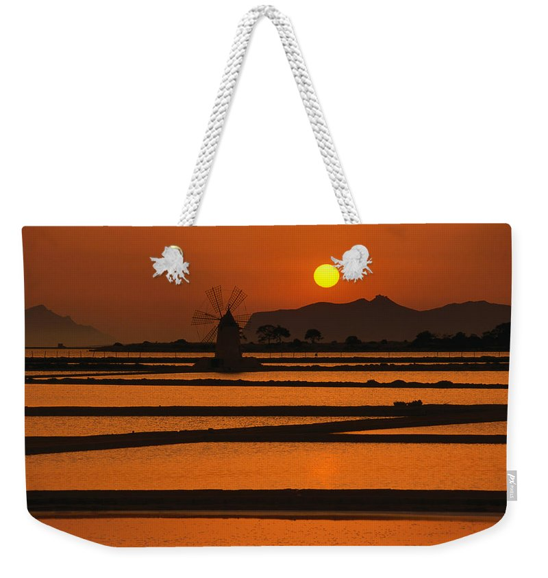 Environmental Conservation Weekender Tote Bag featuring the photograph Sunset Over The Saltpans And A Windmill by Dallas Stribley