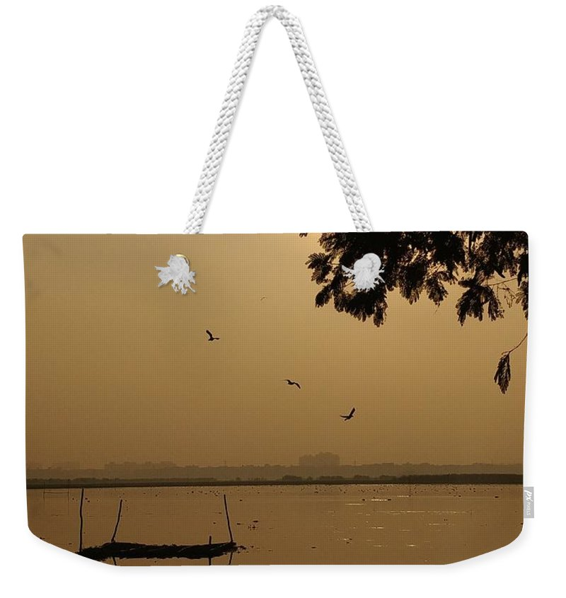 Sunset Weekender Tote Bag featuring the photograph Sunset by Priya Hazra