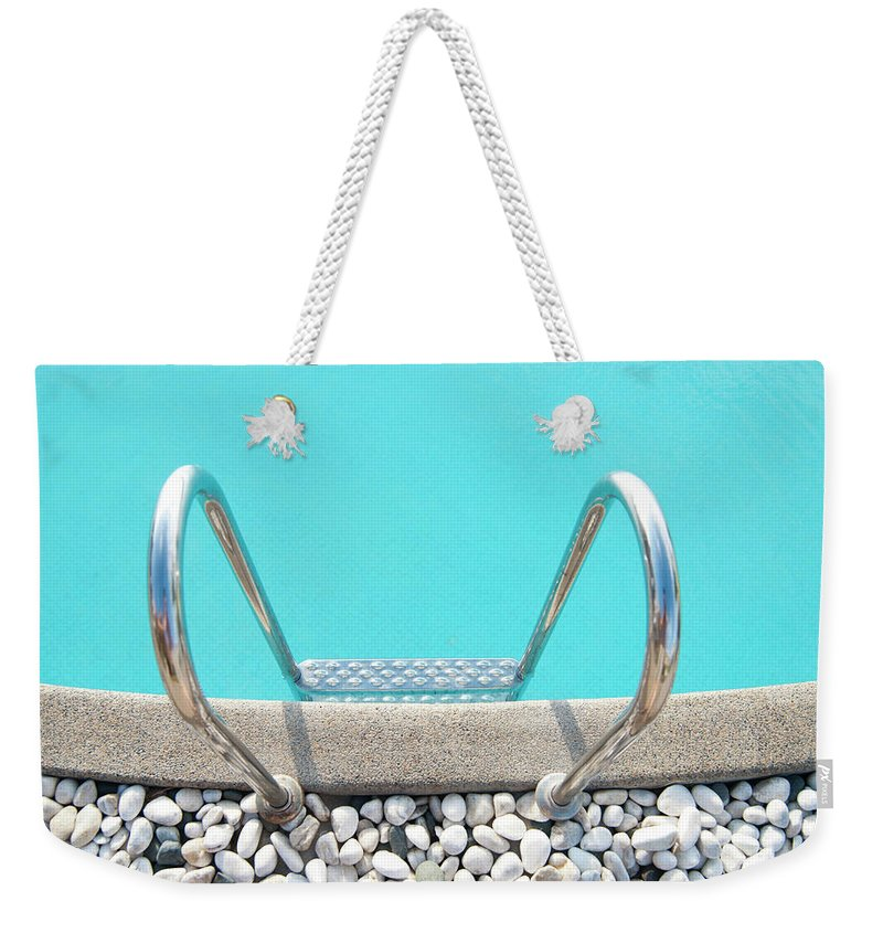Tranquility Weekender Tote Bag featuring the photograph Swimming Pool With White Pebbles by Lawren