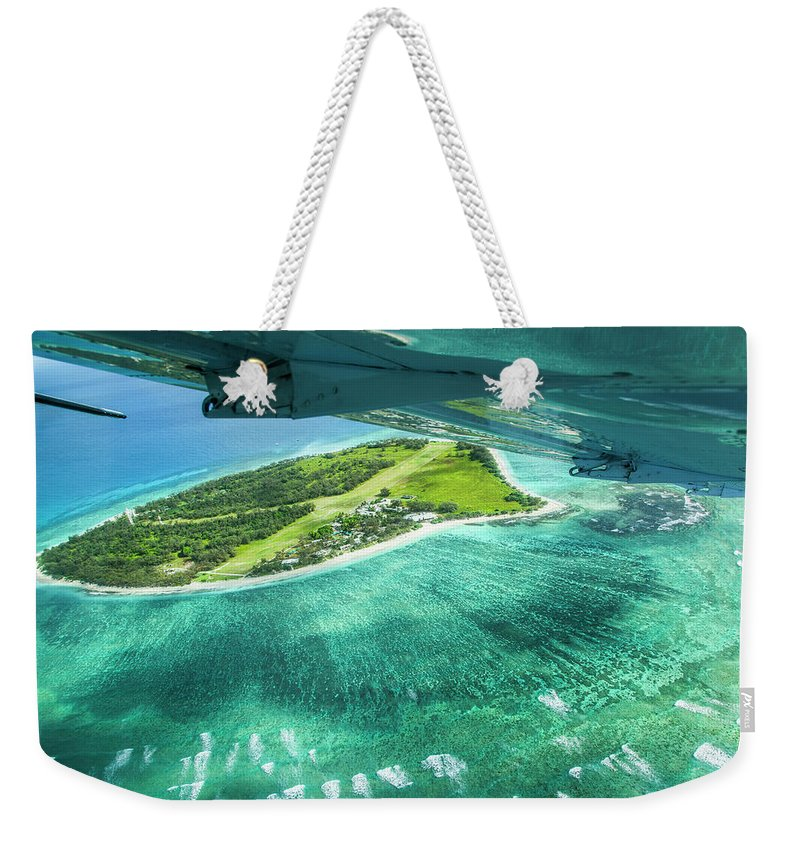 Grass Weekender Tote Bag featuring the photograph Taking Off From Great Barrier Reef by Nick