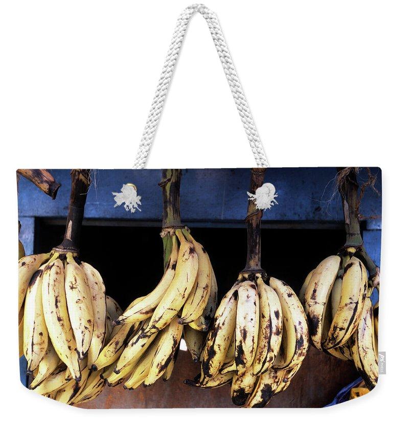 Hanging Weekender Tote Bag featuring the photograph Tanzania, Zanzibar, Bananas For Sale In by John Seaton Callahan