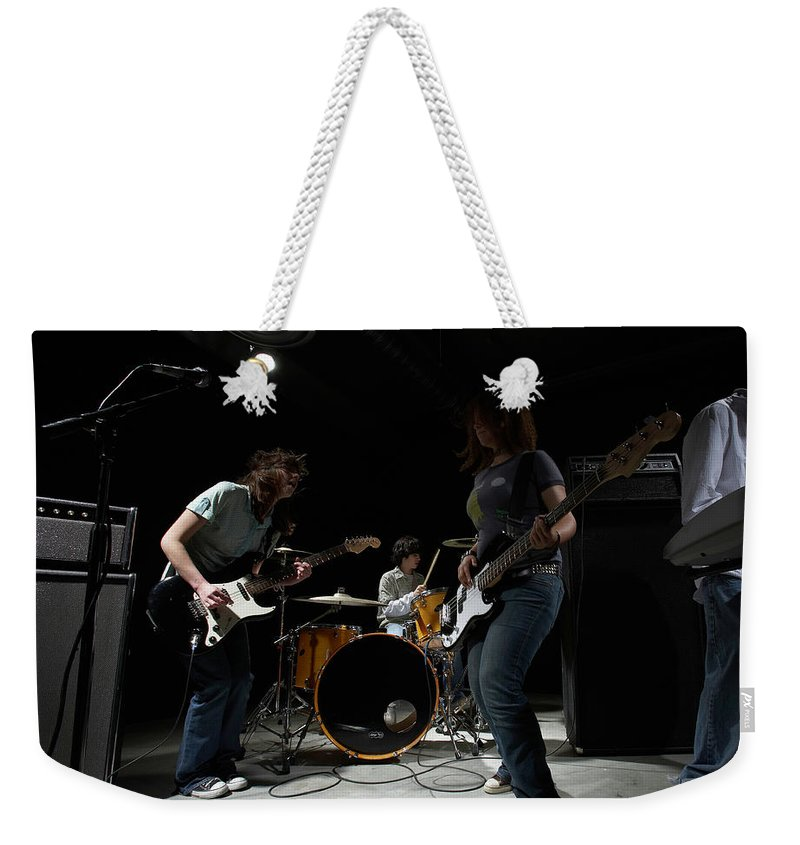 Cool Attitude Weekender Tote Bag featuring the photograph Teenage 14-16 Band Playing Instruments by Thomas Northcut
