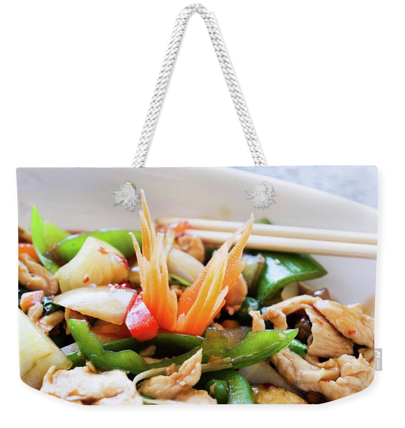 Chicken Meat Weekender Tote Bag featuring the photograph Thai Basil Chicken Dish And Bowl Of by Rapideye