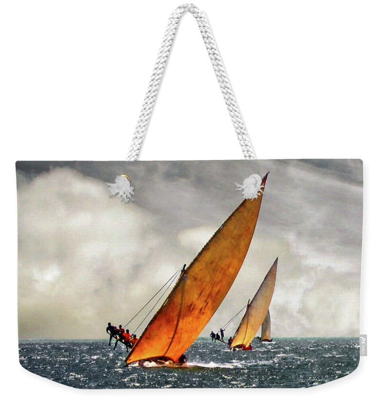 Kenya Weekender Tote Bag featuring the photograph The Art Of Swahili Dhow Racing by David Schweitzer