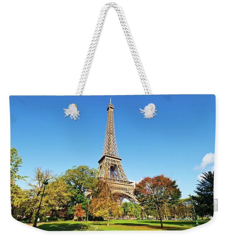 Clear Sky Weekender Tote Bag featuring the photograph The Eiffel Tower With Some Autumnal by Tom Bonaventure