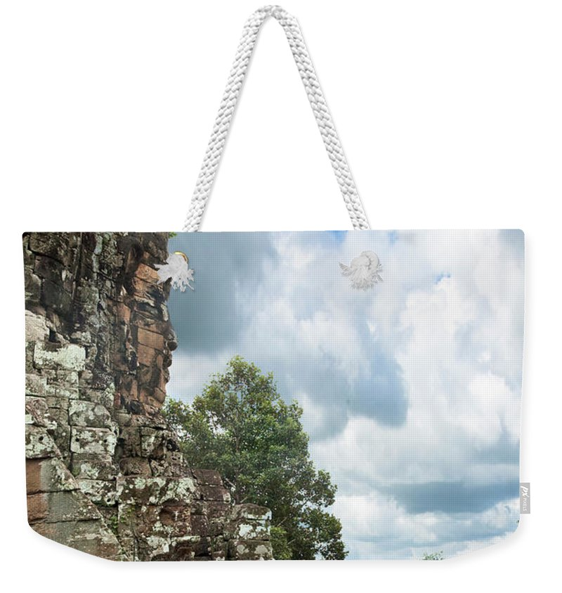 Tropical Rainforest Weekender Tote Bag featuring the photograph The Faces Of Bayon An Angkor In Cambodia by Tbradford