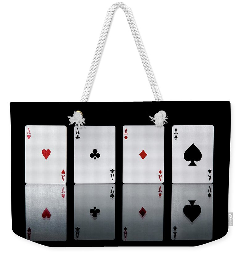 Risk Weekender Tote Bag featuring the photograph The Four Aces From A Pack Of Playing by Sasha Weleber