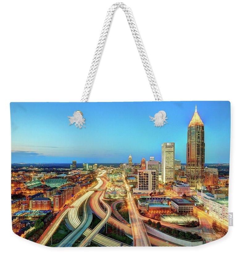 Atlanta Weekender Tote Bag featuring the photograph The Lifeblood Of Atlanta by Photography By Steve Kelley Aka Mudpig