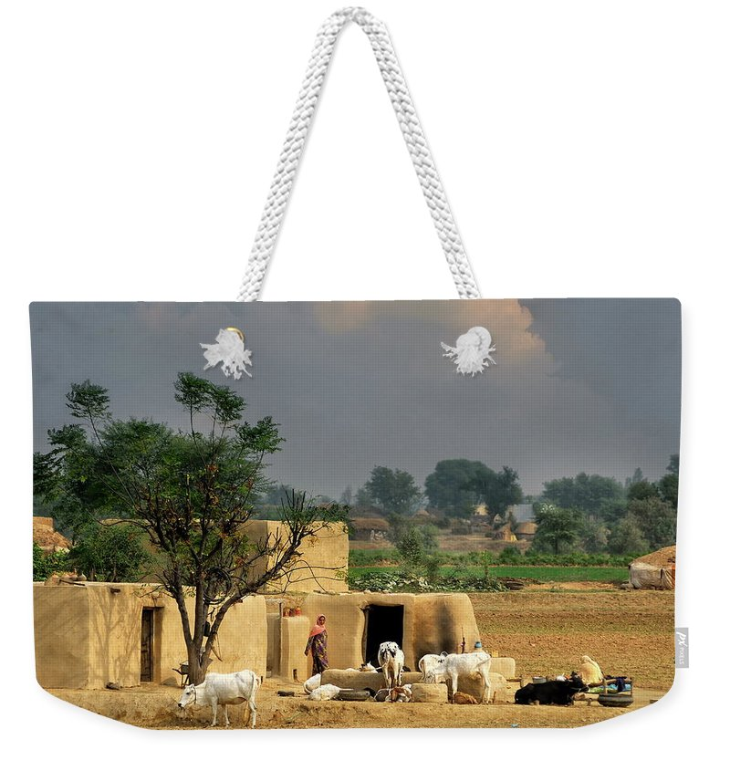 Grass Weekender Tote Bag featuring the photograph The Village Of Punjab by Nadeem Khawar