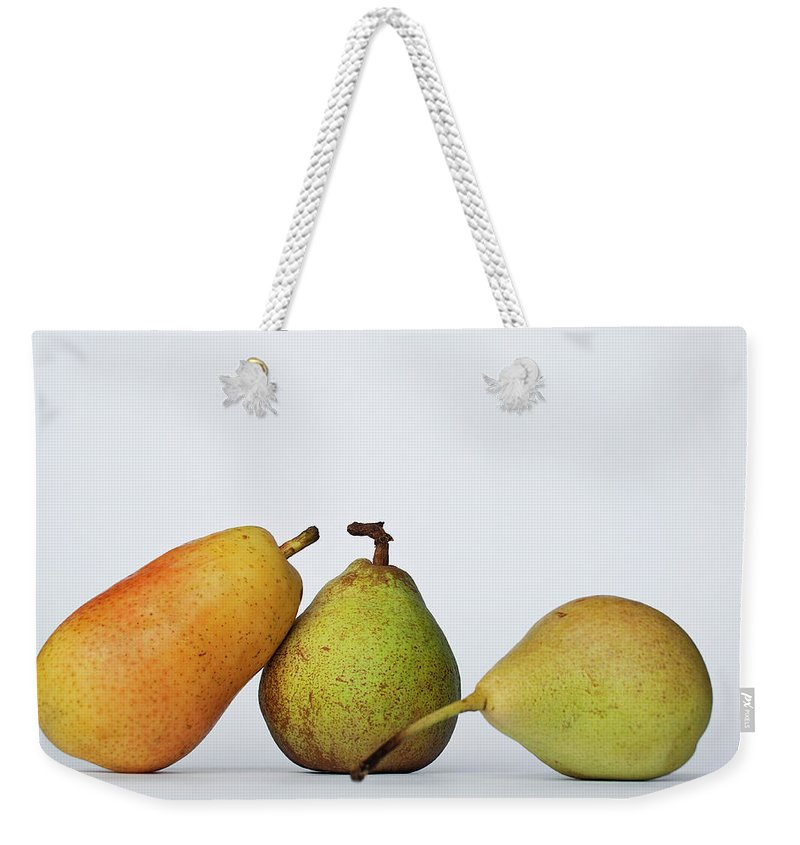 Healthy Eating Weekender Tote Bag featuring the photograph Three Diferent Pears Isolated On Grey by Irantzu Arbaizagoitia Photography