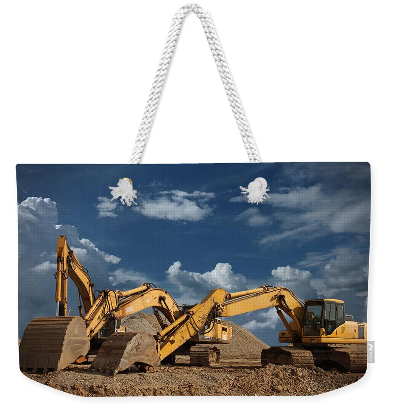 Working Weekender Tote Bag featuring the photograph Three Excavators At Construction Site by Narvikk