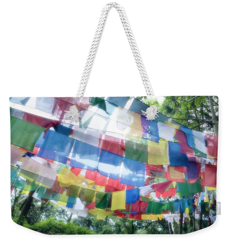 Hanging Weekender Tote Bag featuring the photograph Tibetan Buddhist Prayer Flags by Glen Allison