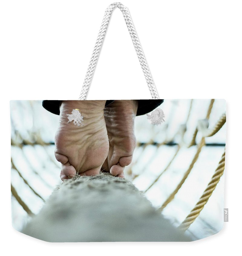 People Weekender Tote Bag featuring the photograph Tight Rope by Www.flickr.com/photos/persnicketydame