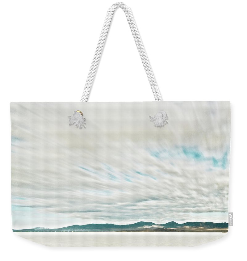 Tranquility Weekender Tote Bag featuring the photograph Time Exposure Clouds In Motion Above by Andy Ryan