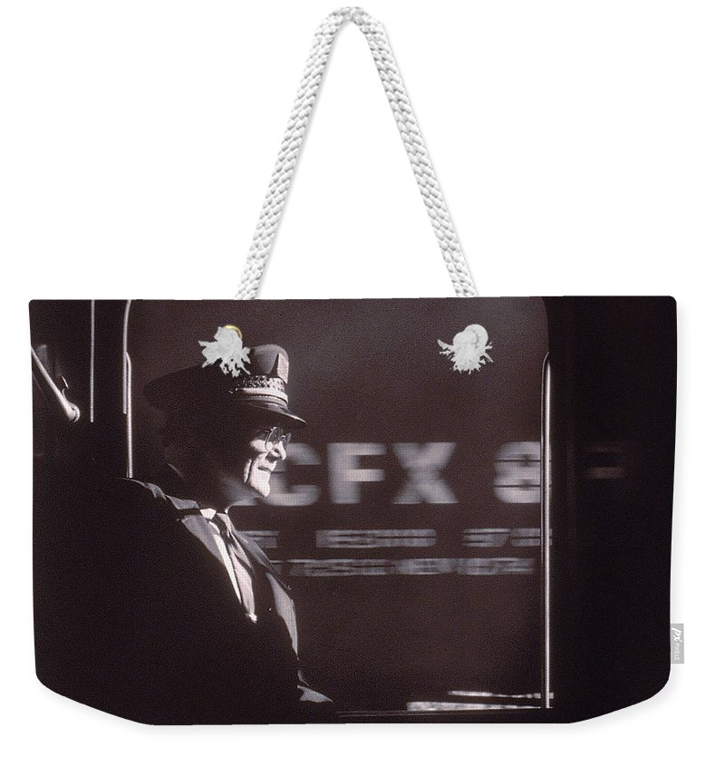Working Weekender Tote Bag featuring the photograph Train Conductor Looking Out Of Window by John Coletti
