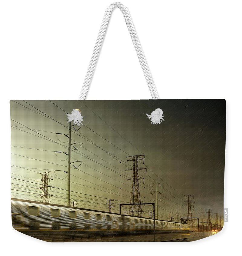 Train Weekender Tote Bag featuring the digital art Train Speeding By Power Lines by Chris Clor
