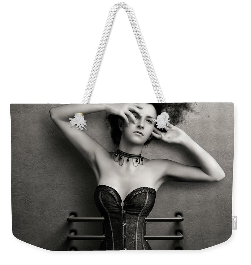 Woman Weekender Tote Bag featuring the photograph Trapped by Johan Swanepoel
