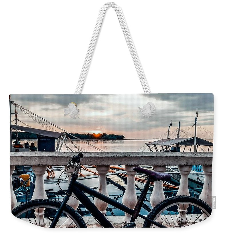 Bike Weekender Tote Bag featuring the photograph Traveller's Point by Dynz Abejero