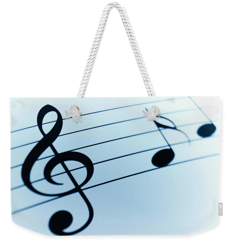 Sheet Music Weekender Tote Bag featuring the photograph Treble Clef And Notes by Adam Gault
