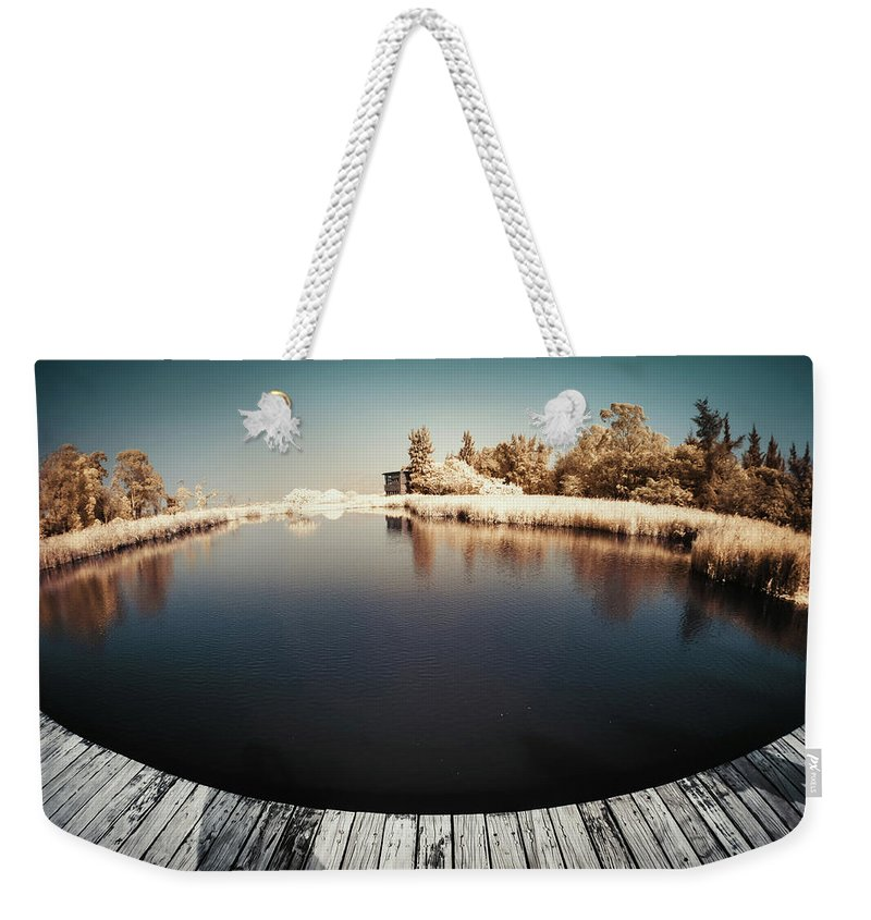 Tranquility Weekender Tote Bag featuring the photograph Trees And Plants In A Pond by D3sign
