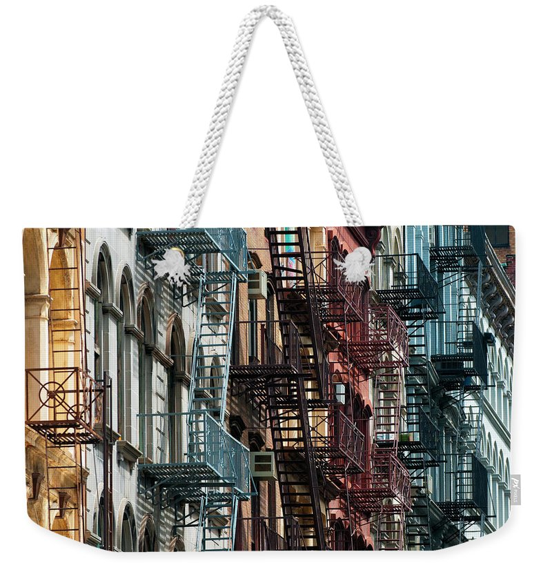Downtown District Weekender Tote Bag featuring the photograph Tribeca Fire Escapes by Joseph O. Holmes / Portfolio.streetnine.com