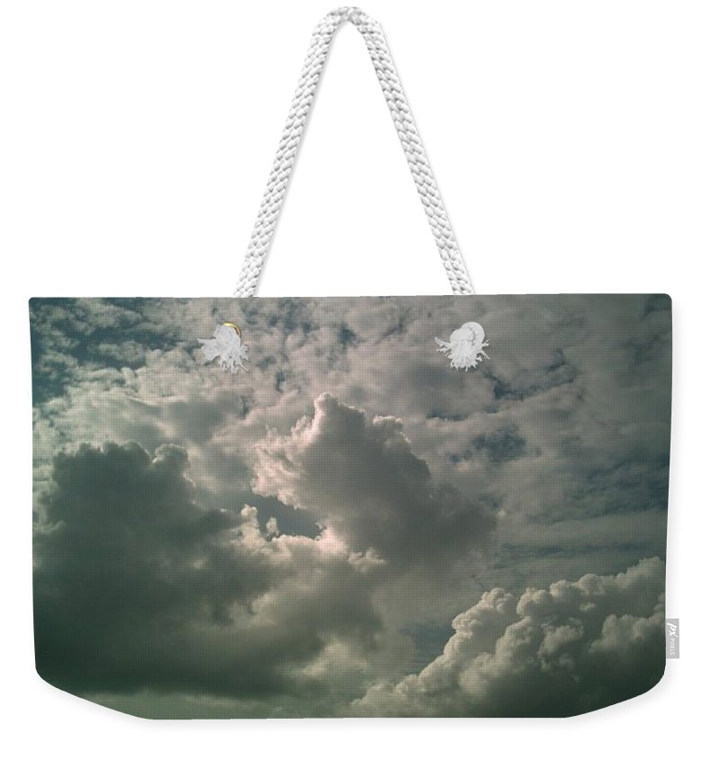 Cloud Weekender Tote Bag featuring the photograph Trinity by Jeff Thomann