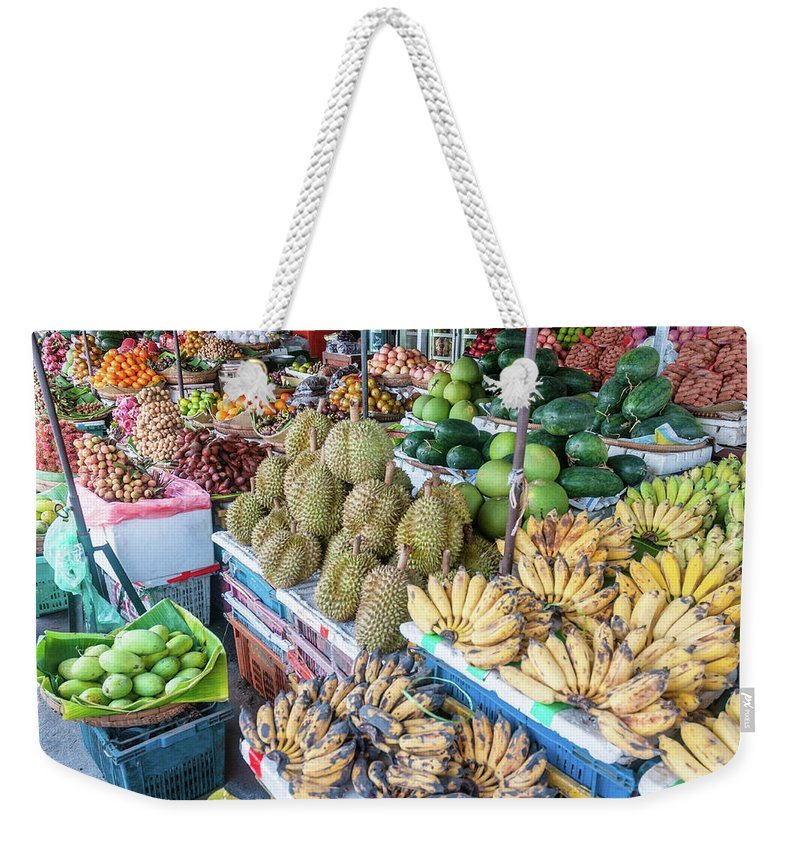 Mango Fruit Weekender Tote Bag featuring the photograph Tropical Fruit At A Street Market In by Tbradford