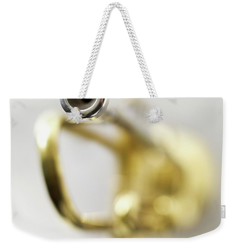 White Background Weekender Tote Bag featuring the photograph Trumpet, Focus On Mouth Piece by Stockbyte
