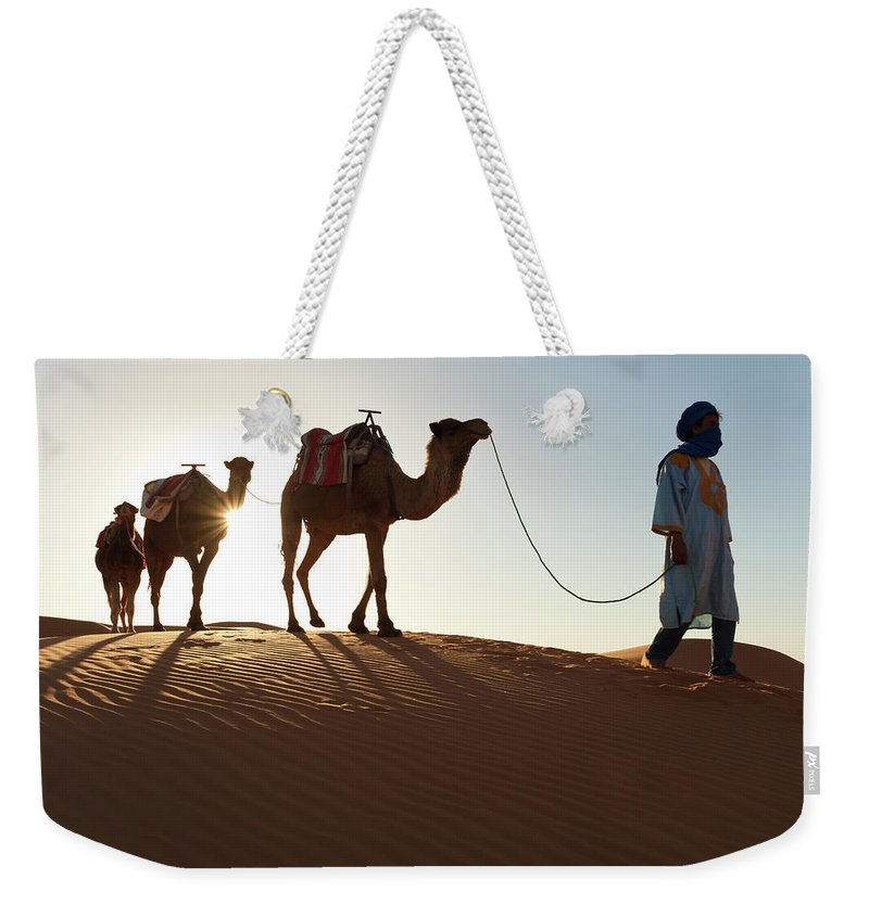 People Weekender Tote Bag featuring the photograph Tuareg Man & Camels, Erg Chebbi, Sahara by Peter Adams