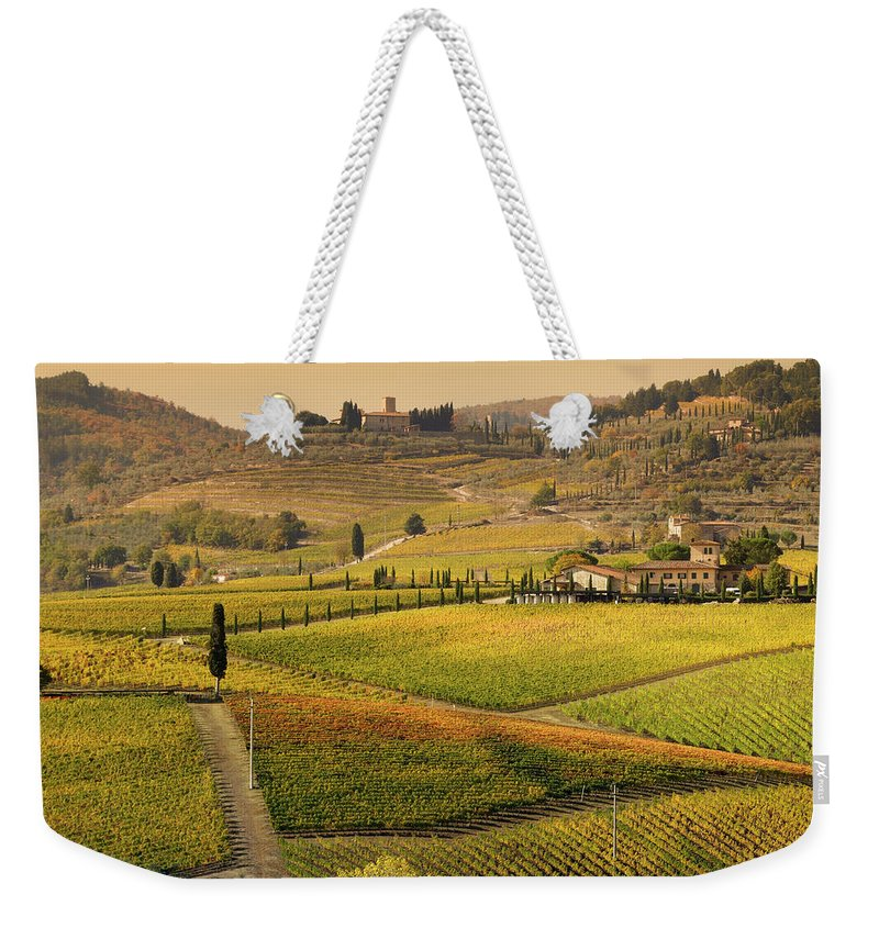 Scenics Weekender Tote Bag featuring the photograph Tuscany Farmhouse And Vineyard In Fall by Lisa-blue