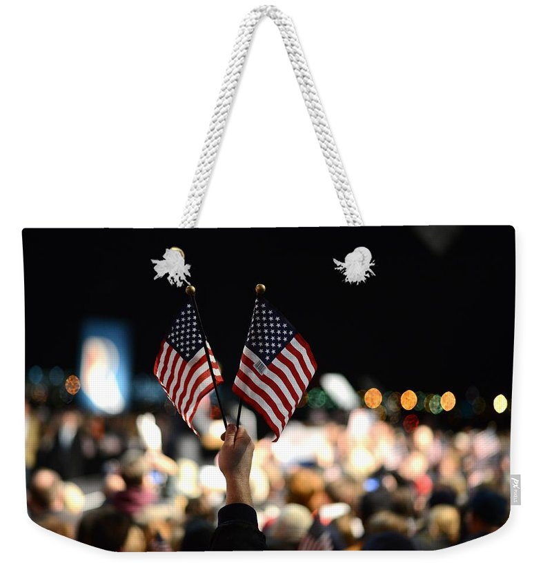 Crowd Weekender Tote Bag featuring the photograph Twin Flags by Mikael Törnwall