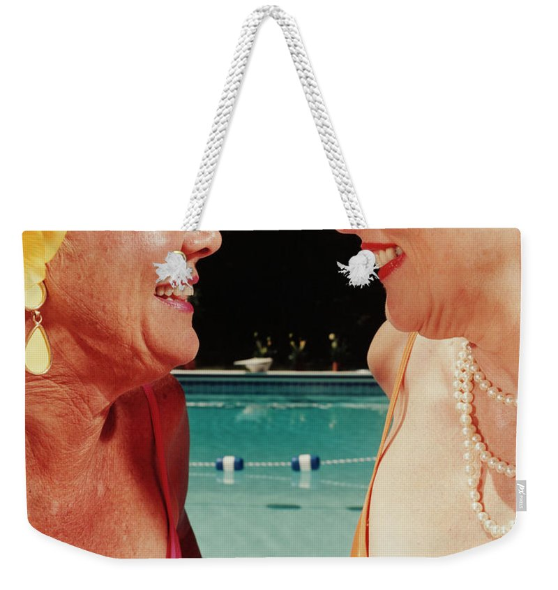 Mature Adult Weekender Tote Bag featuring the photograph Two Women By Pool by Silvia Otte