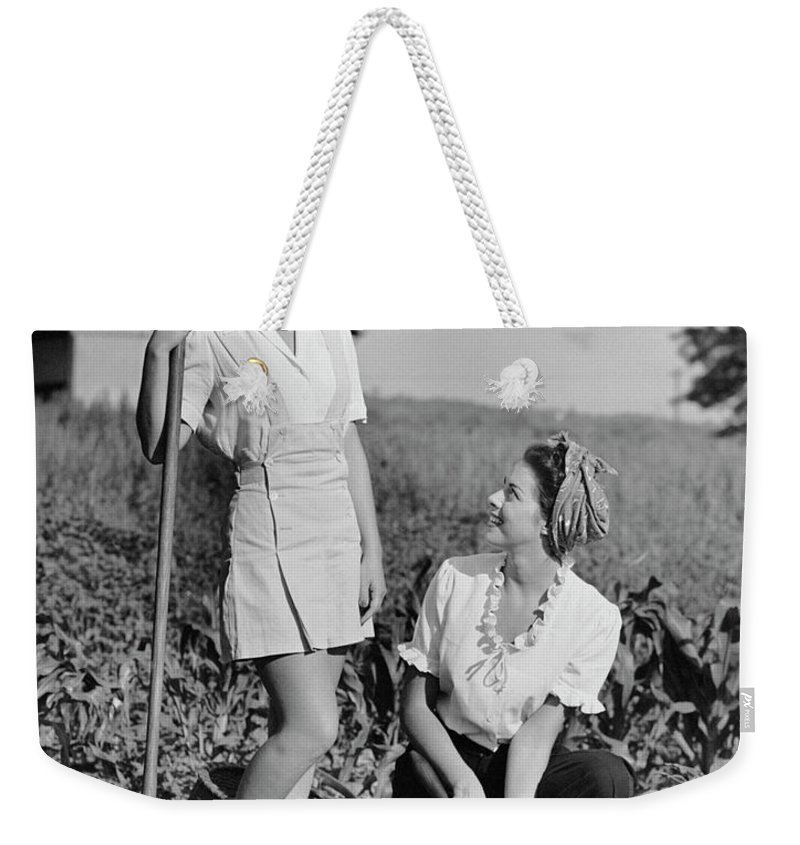 People Weekender Tote Bag featuring the photograph Two Women Gardening In Field by George Marks