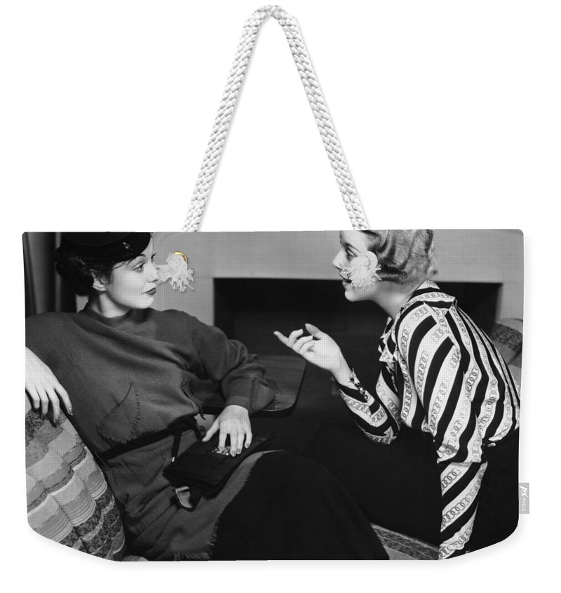 Three Quarter Length Weekender Tote Bag featuring the photograph Two Women In Casual Conversation by George Marks