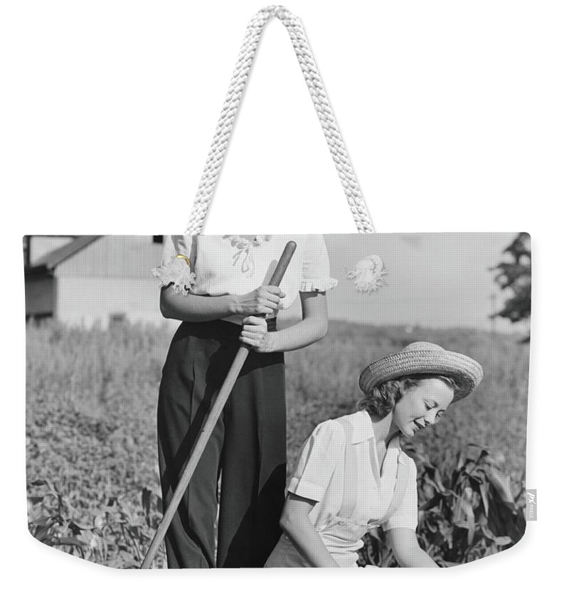 Straw Hat Weekender Tote Bag featuring the photograph Two Women Working On Field, B&w by George Marks