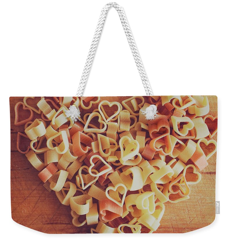 Italian Food Weekender Tote Bag featuring the photograph Uncooked Heart-shaped Pasta by Julia Davila-lampe