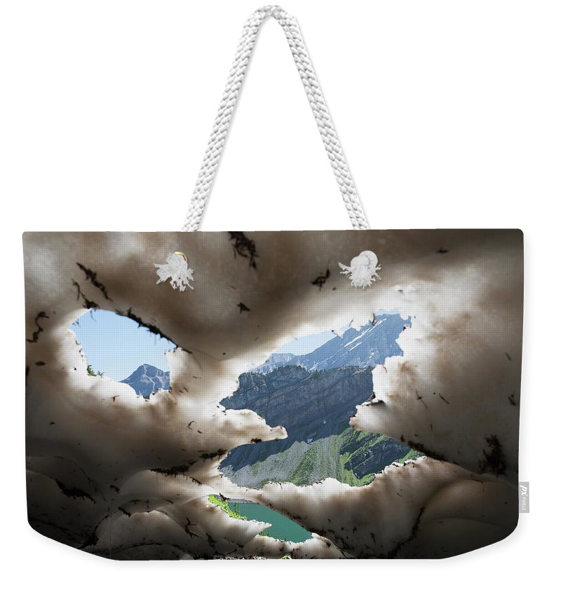 Scenics Weekender Tote Bag featuring the photograph Underneath A Melting Snow Pack With by Michael Interisano / Design Pics