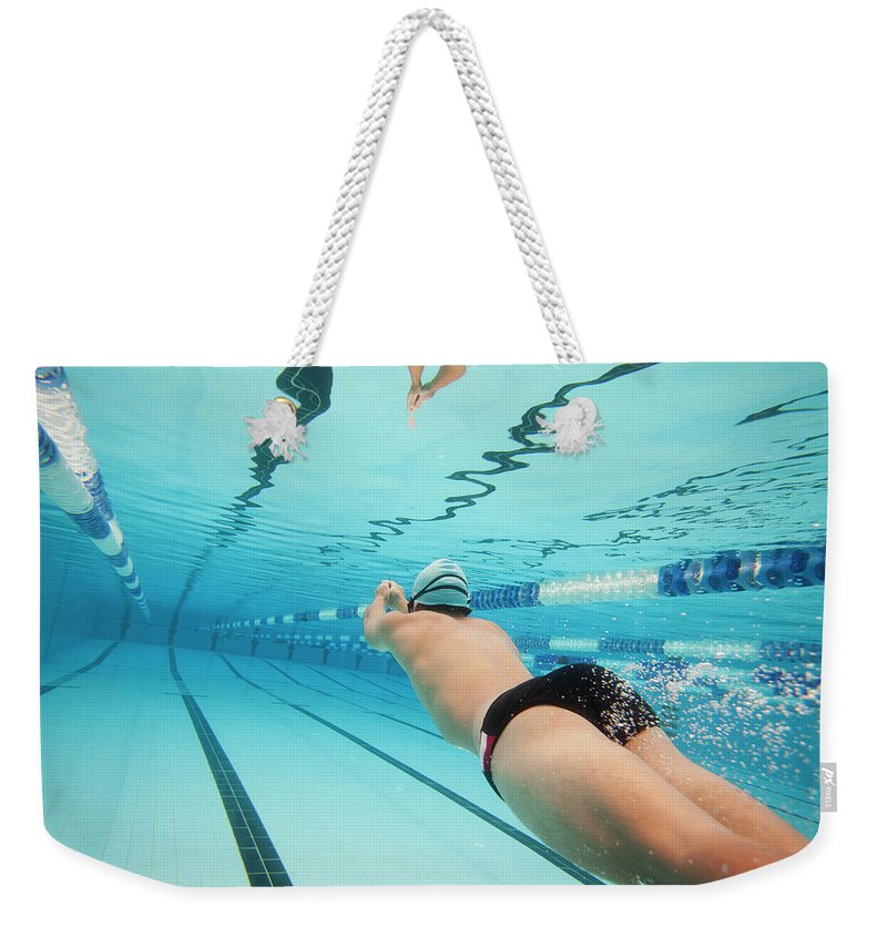 Underwater Weekender Tote Bag featuring the photograph Underwater Swimmer by David Freund