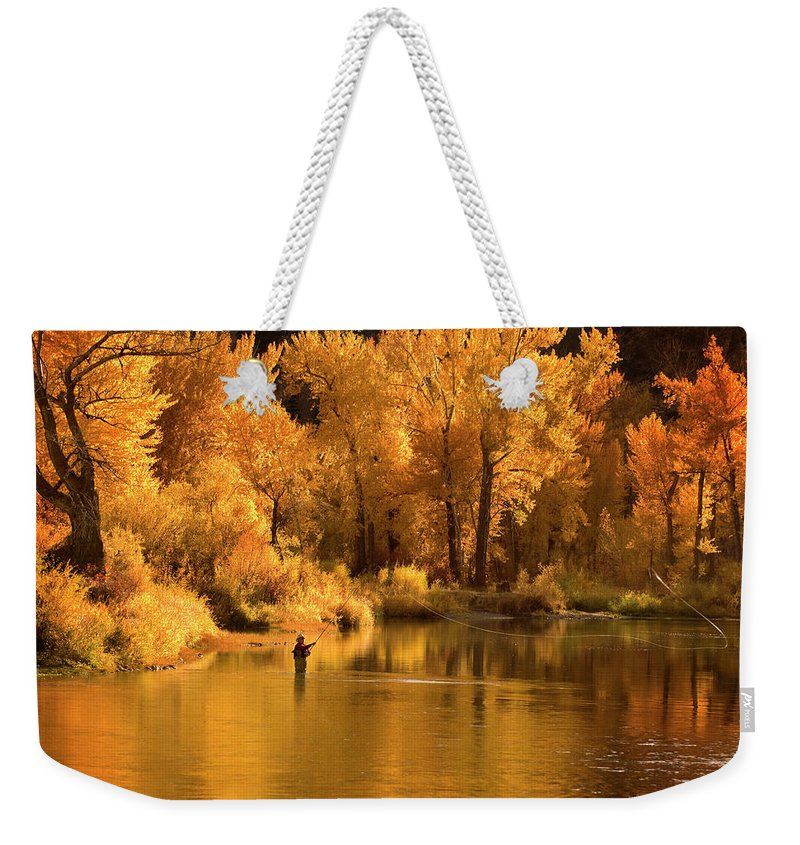 Orange Color Weekender Tote Bag featuring the photograph Usa, Idaho, Salmon River, Mature Man by Steve Bly