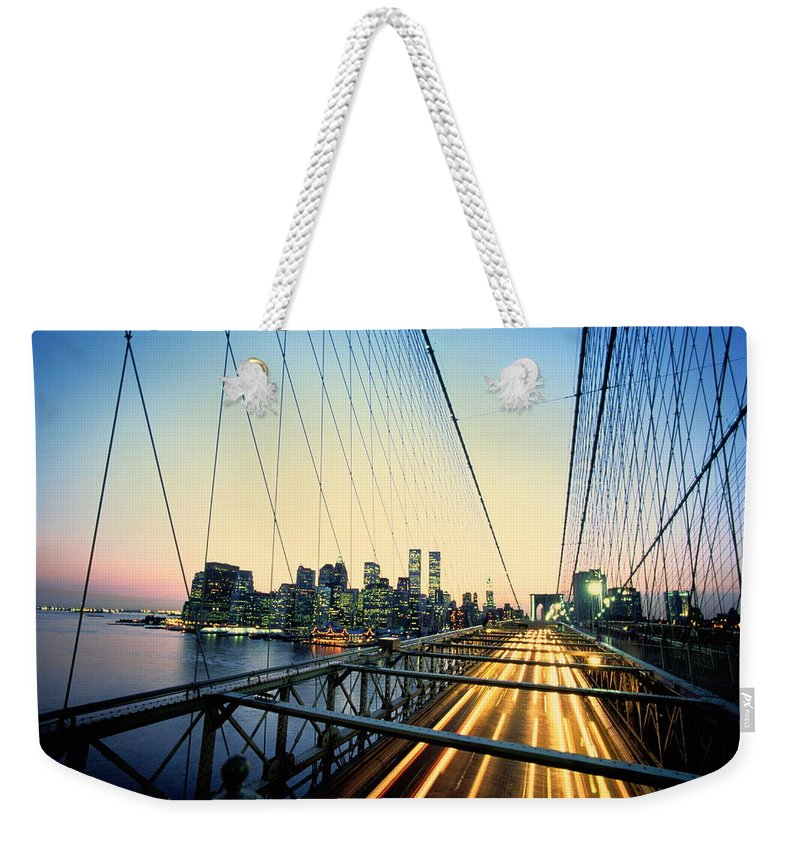 Twin Towers Weekender Tote Bag featuring the photograph Usa, New York City, Manhattan, View by Paul Radenfeld