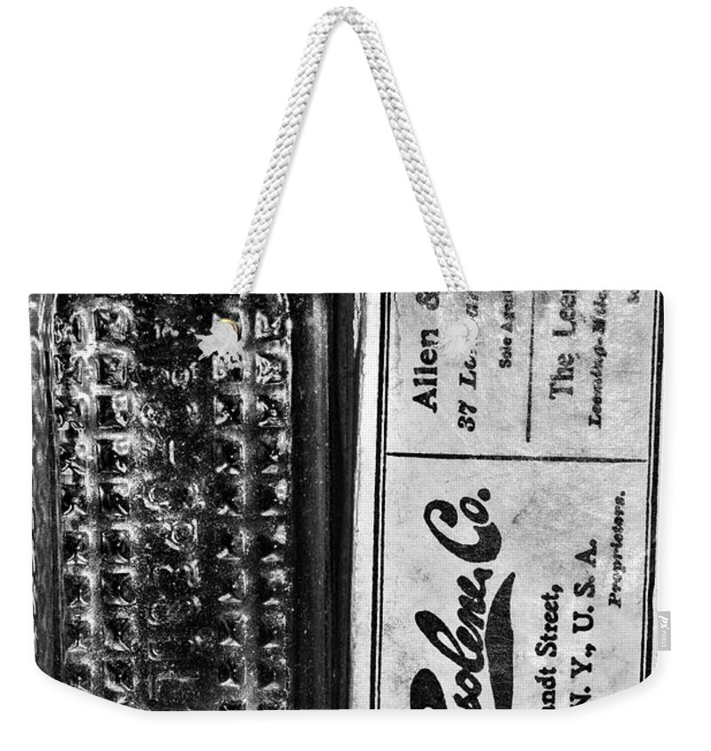 Paul Ward Weekender Tote Bag featuring the photograph Vapo-cresolene Vaporizer Liquid Poison Bottle Black And White by Paul Ward